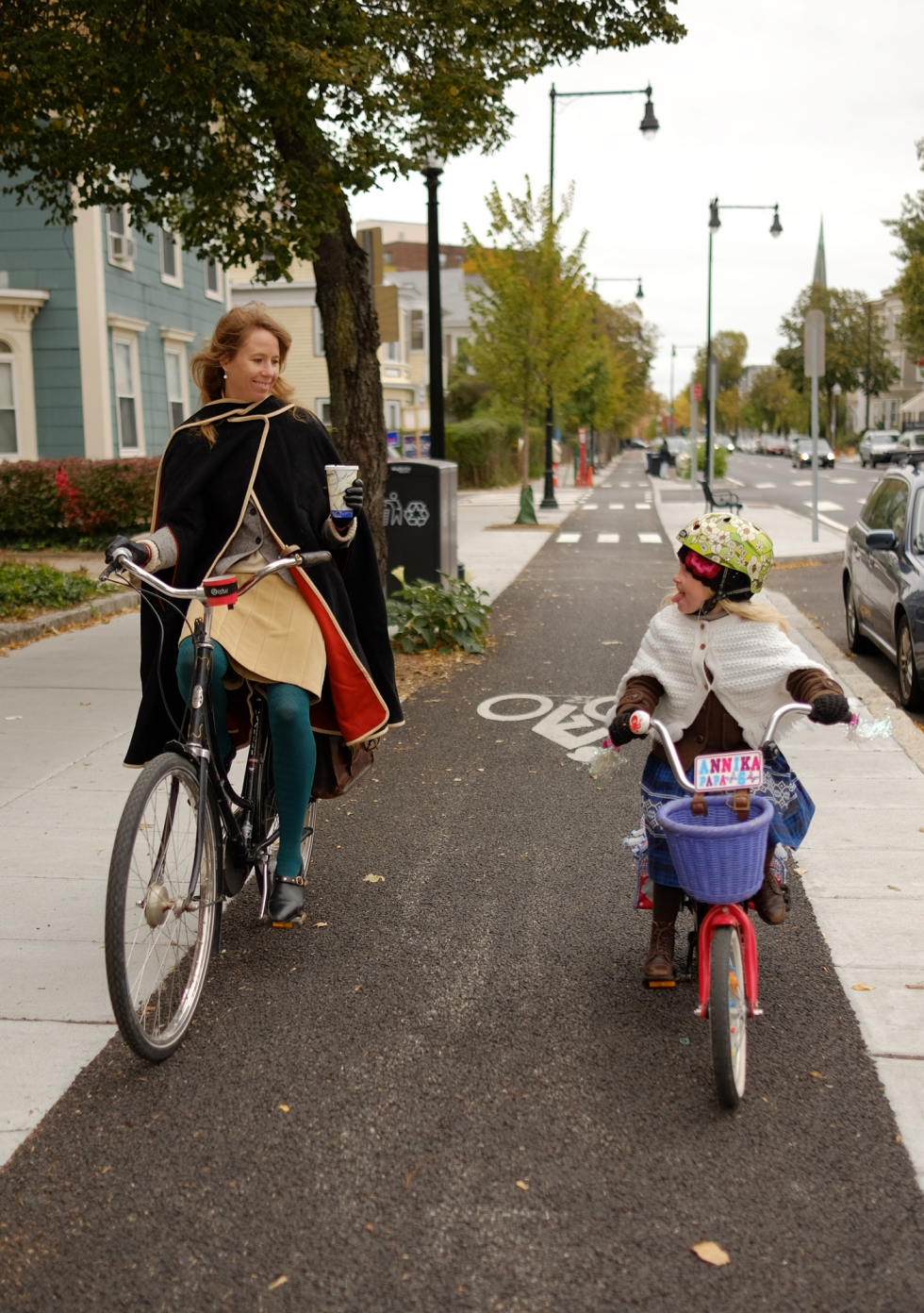 Bikabout-Boston-mother-daughter-biking-on-Western-Ave-cycle-track